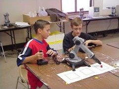 Boys with joystick controlled RoboAC